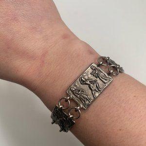 Vintage silver panel ancient motif story bracelet